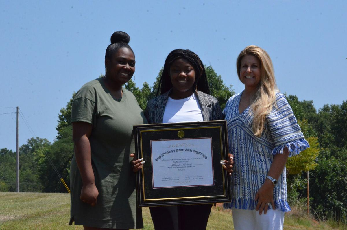 Aletha Daye, Juh'Quayden McCollough, and Vicki Winthrop pose for a photo at the Boy's and Girls Club to celebrate McCollough receiving the first Abby Winthrop's Smart Girls Scholarship.