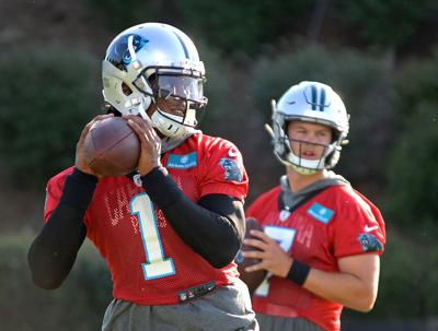 Carolina Panthers quarterback Cam Newton (1) prepares to throw a pass as quarterback Kyle Allen, right, looks on during the team's first practice of training camp at Wofford College in Spartanburg, S.C., on Thursday, July 25, 2019. Newton is signing a one-year deal with the New England Patriots.