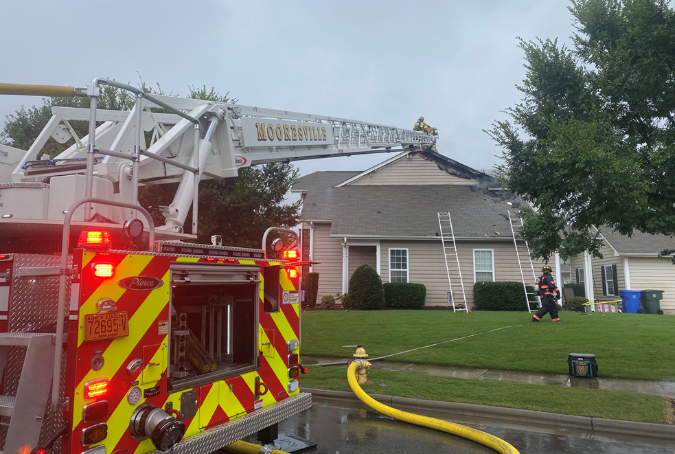 A ladder truck is used by fire departments to help extinguish a fire on Leyton Loop in Mooresville on Monday.