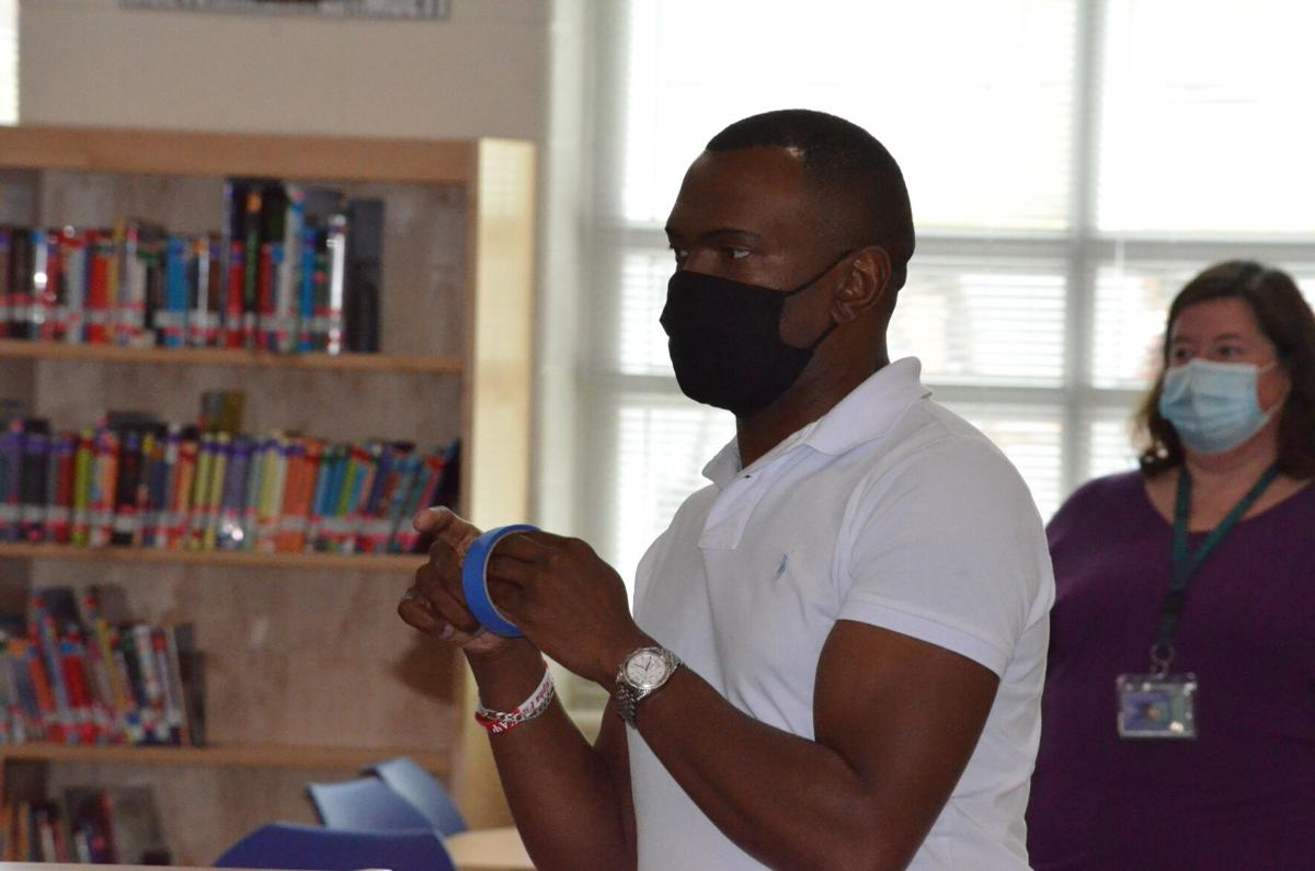 Dr. Darwin Carter speaks to parents at a summer school open house at Third Creek Middle School in Statesville on Thursday.