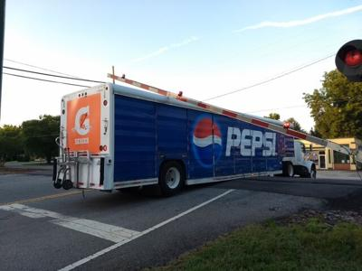 Pepsi truck stuck on Rutledge rail crossing