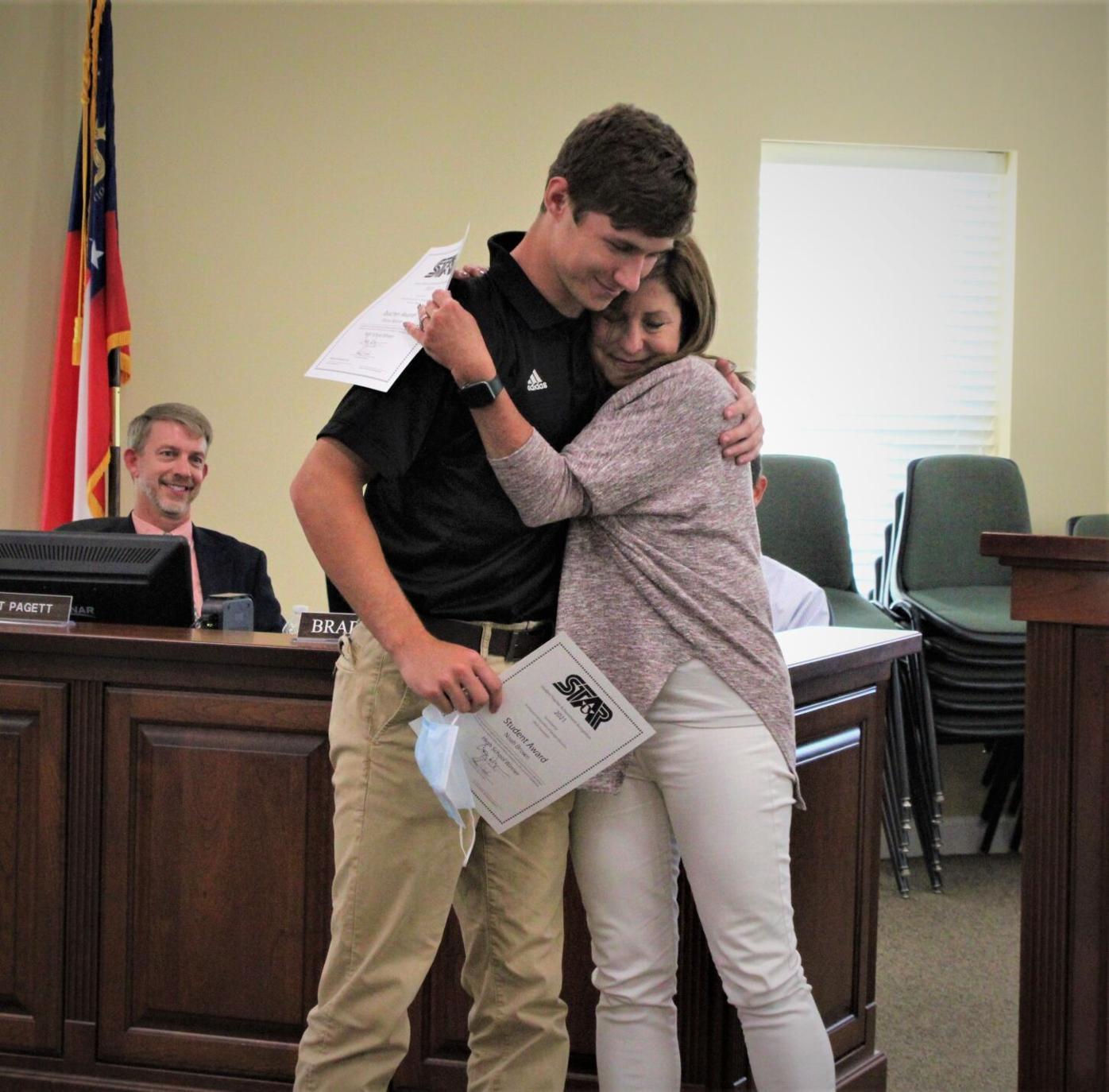 Star student hug
