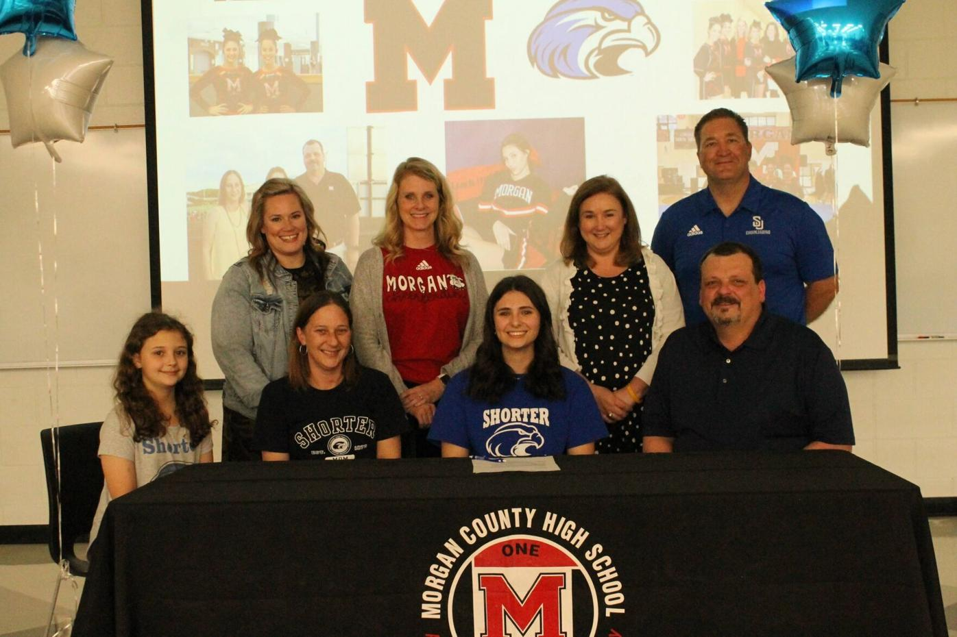 Kaitlyn Sims signing with parents