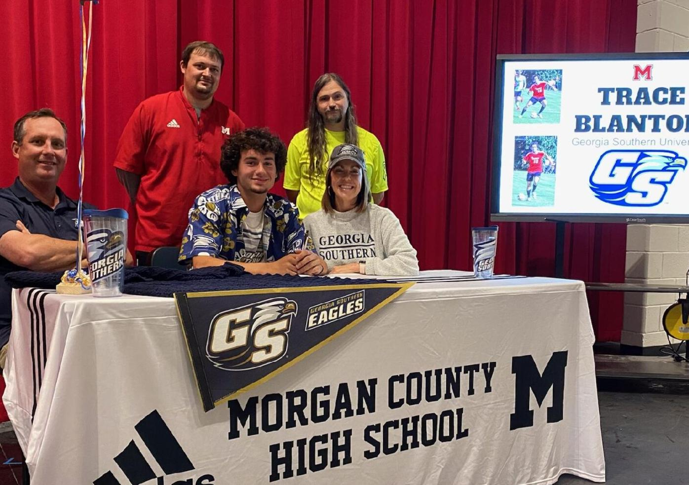 blanton signing with parents: coaches.jpg