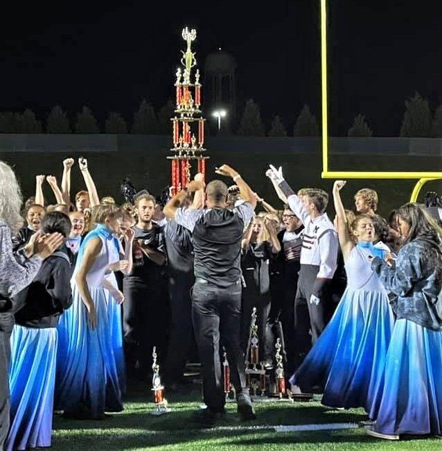 Band celebrates around trophy