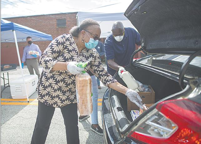 Volunteer loads trunk