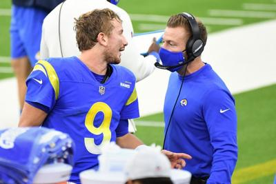 Los Angeles Rams quarterback John Wolford talks with head coach Sean McVay on the sideline at SoFi Stadium in Inglewood, Calif., on Jan. 3, 2021..