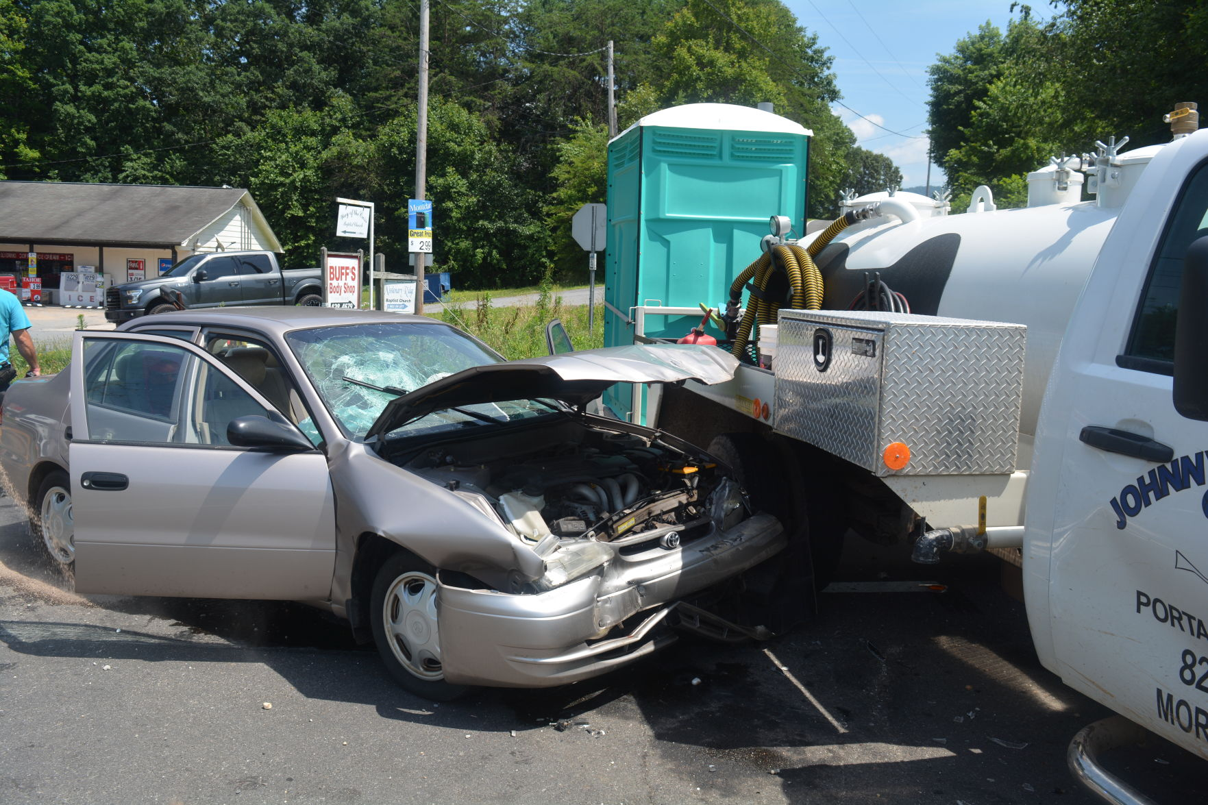 porta potty wreck 1 injured 1 charged