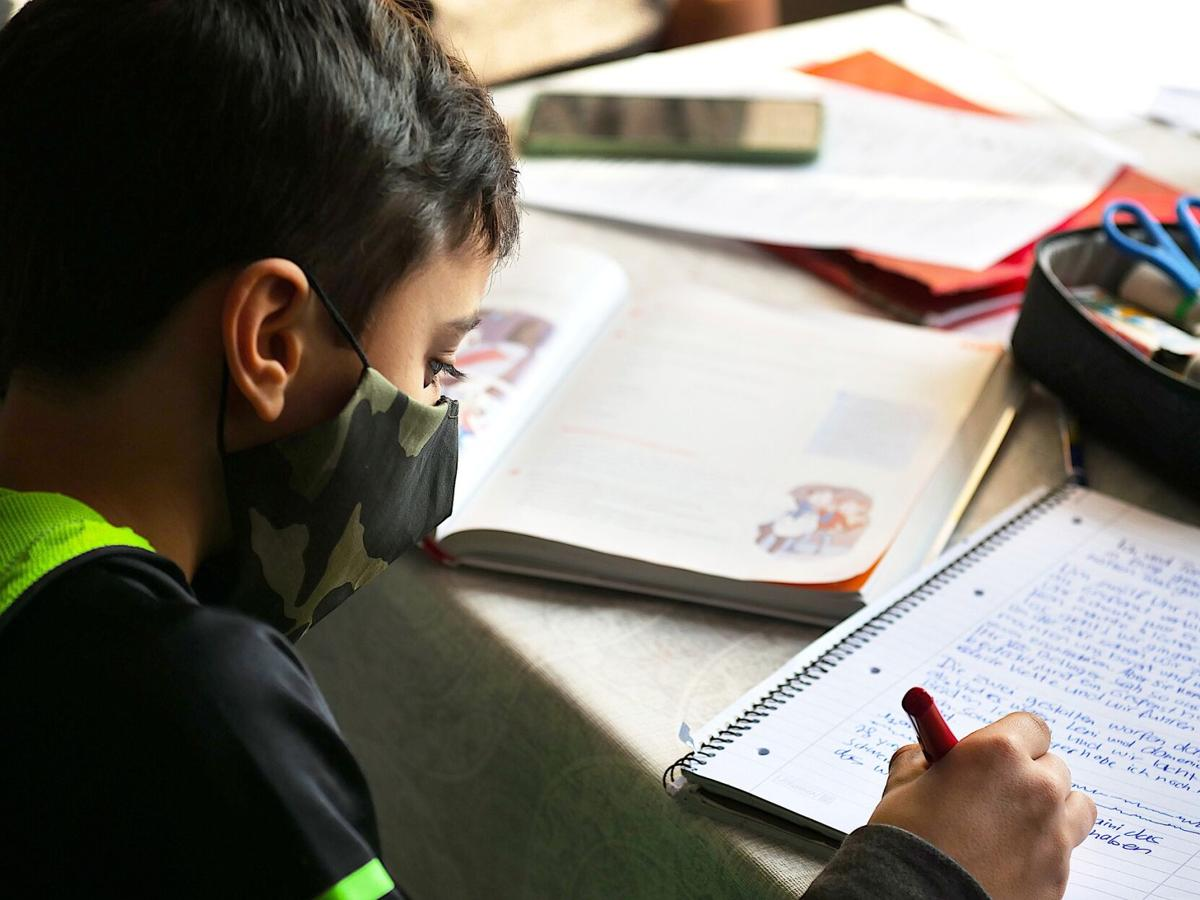 mnh-stock-boymaskschoolwork