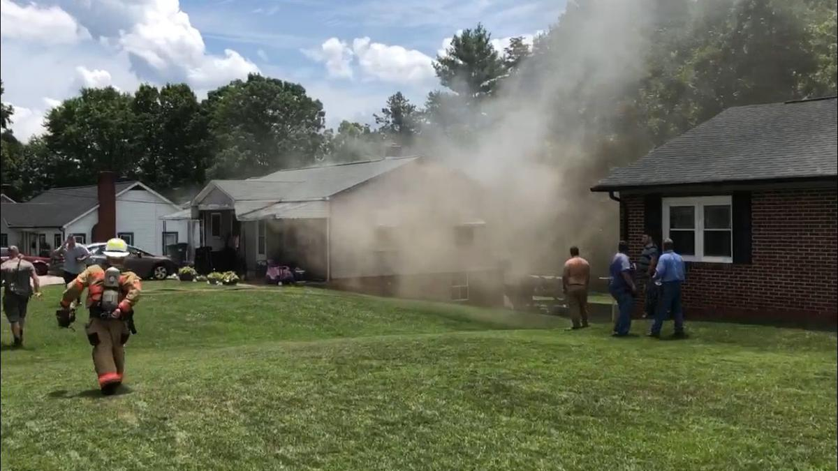 BREAKING: Woman pulled out of house fire, condition unknown
