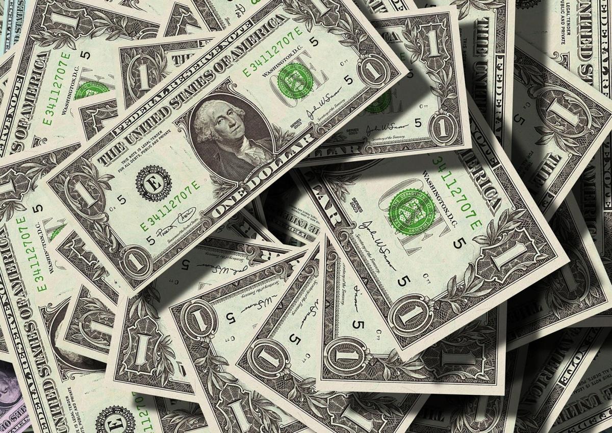 dollars money pile