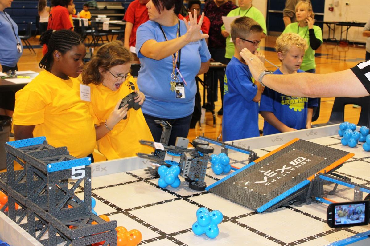 School holds robotics competition teaches students engineering