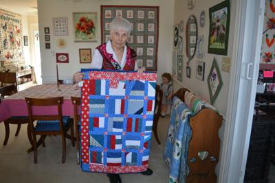 Joan Cole with Quilt of Valor pic