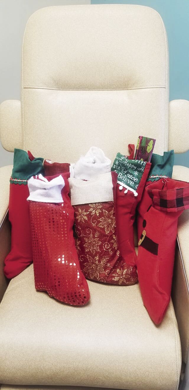 Stuffed with Love Christmas stockings sitting in a chemotherapy patient's chair at Tennessee Oncology-Sklyine in 2018..jpg