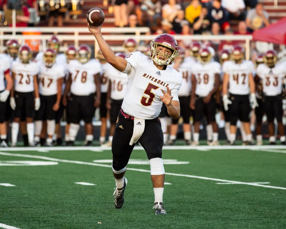 Riverdale's Taylor Yancey (5) throws to an open receiver.jpg