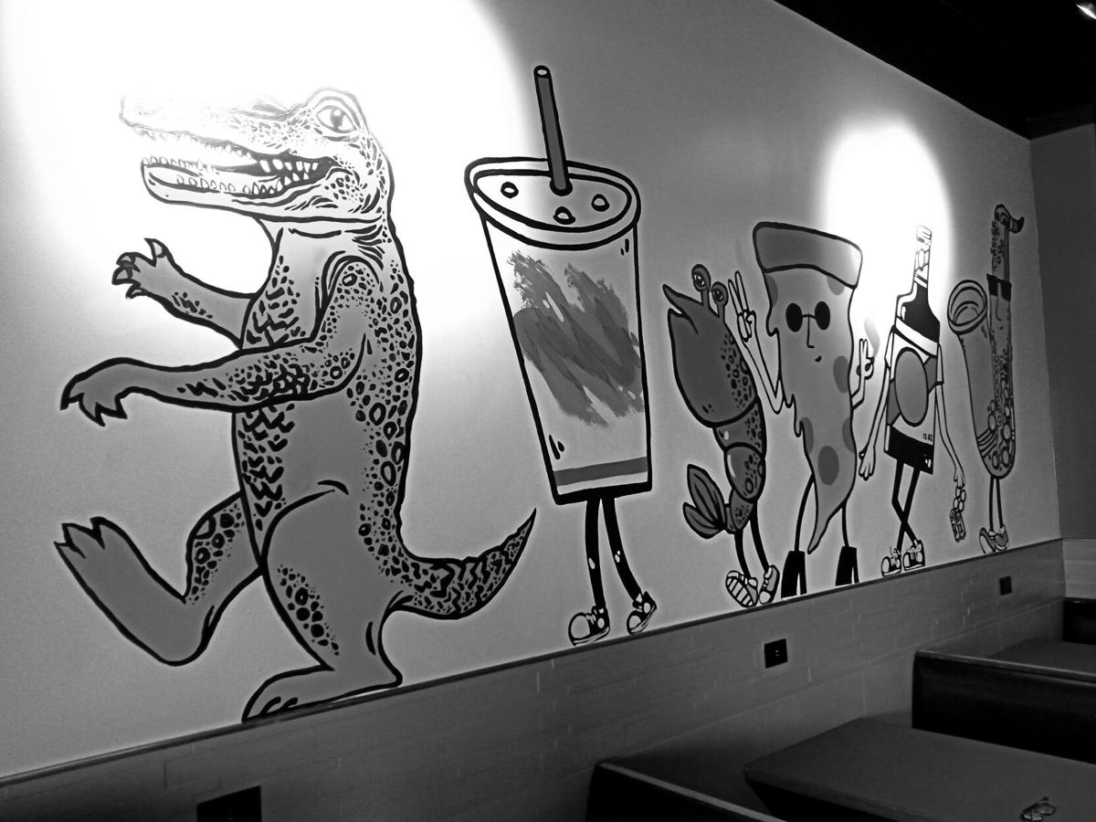 Original artwork in the dining room of Two Boots Pizza Smyrna.jpg