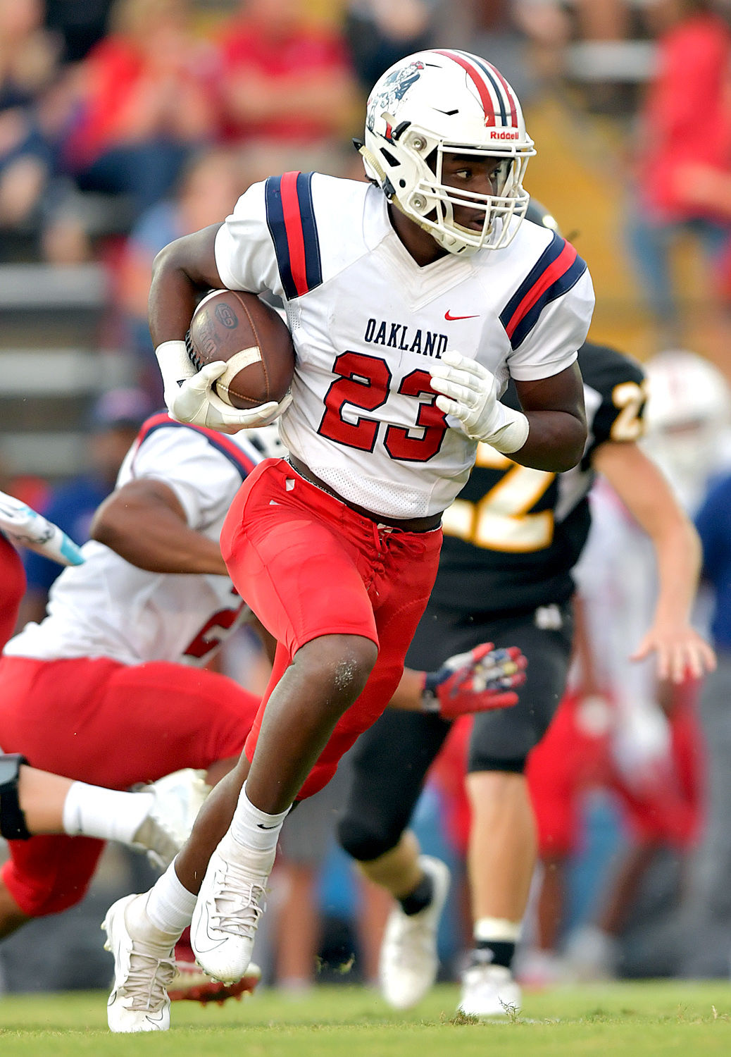 BJ Connard finished the first half with 125 yards and one touchdown to lead the Patriot rushing attack. DON MCPEAK