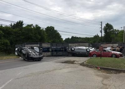 Truck wreck scatters new cars