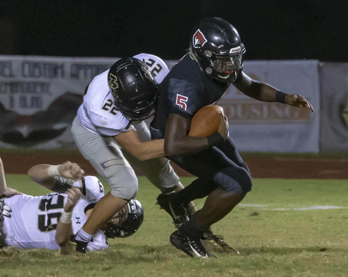 Mt. Juliet's Donovan Lewis comes in for the sack on Stewarts Creek's Jonnie Simmons.jpg