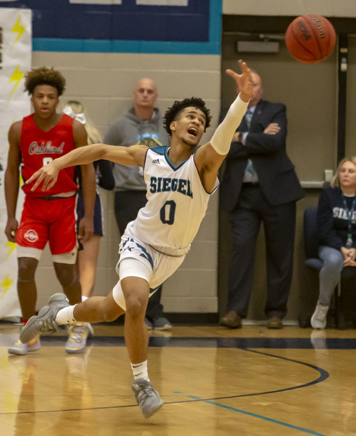 Siegel boys whip District 7 unbeaten Oakland 58-38