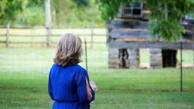 Sherry Tidwell gazing at the Sam Davis boyhood home