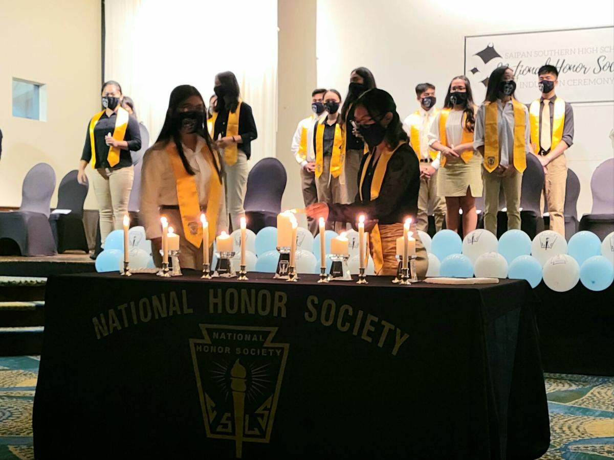 Inductees light candles