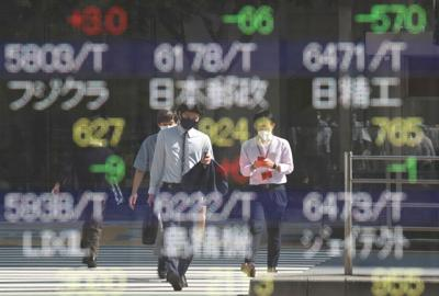 Japan's stock prices outside a brokerage in Tokyo