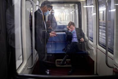 Senator Warner rides the Senate Subway following a vote on Capitol Hill in Washington