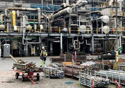 A worker walks at the Yara ammonia plant in Porsgrunn