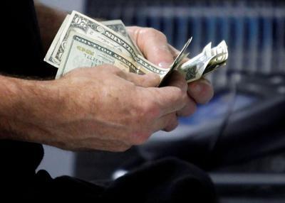 Customer counts his cash