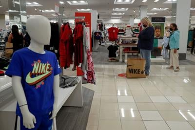 People shop at Macy's department store