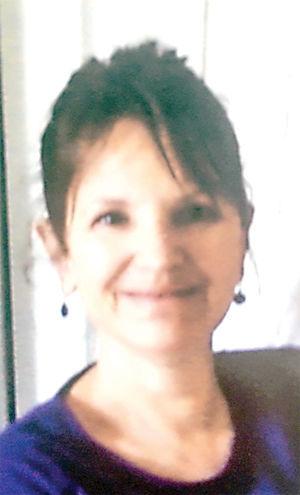 ROXANNE M. HOLCOMB