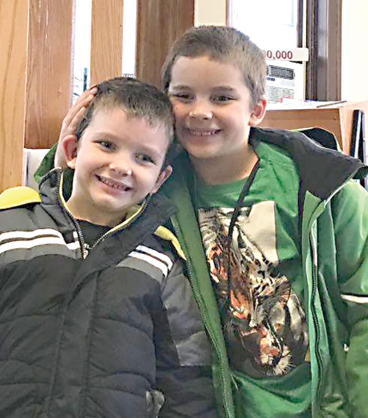 Brothers donate Christmas to library project