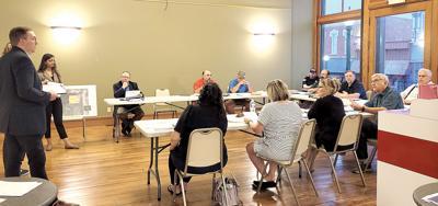 Center sites, plans spur questions, debate