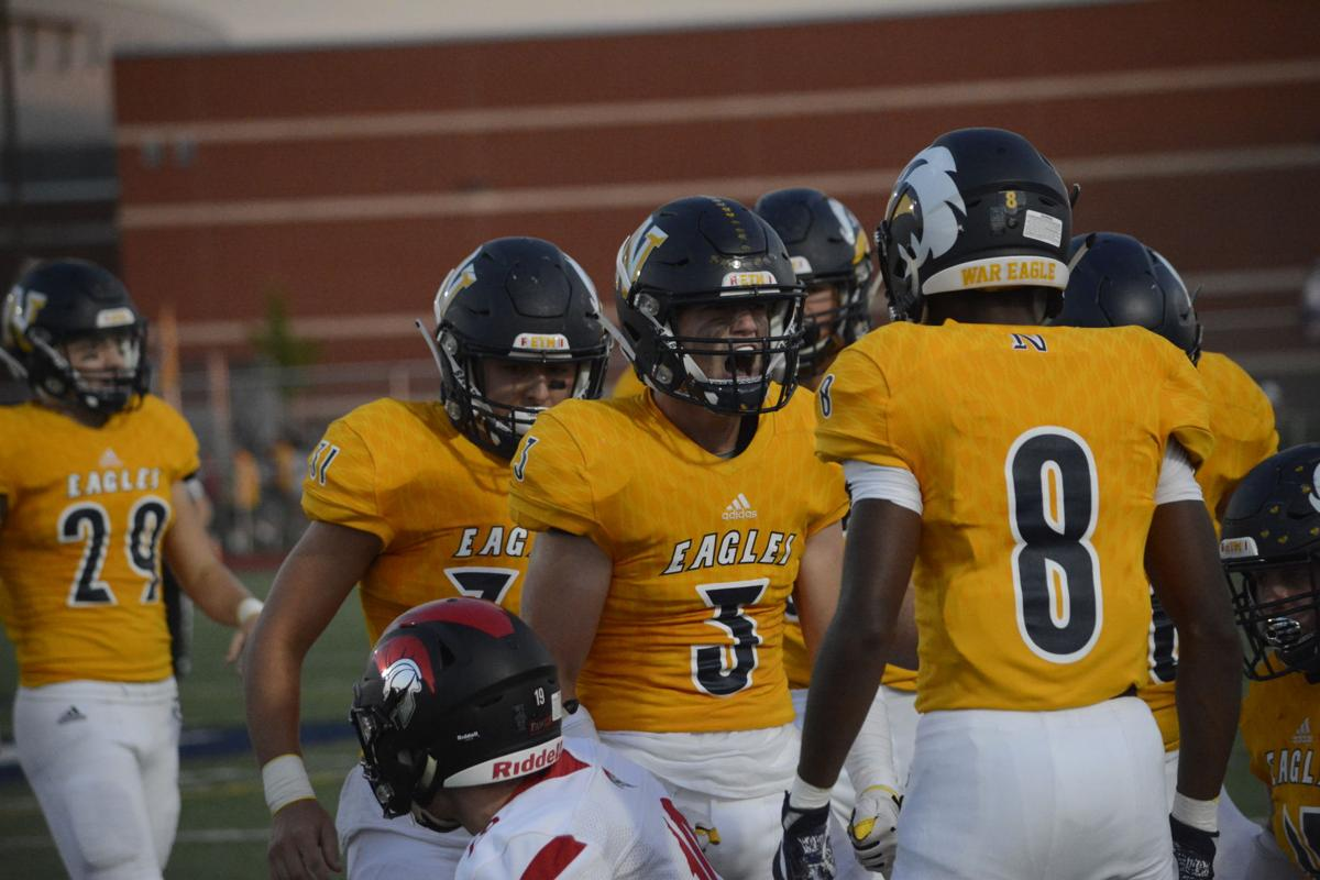 Defense lifts Eagles to statement win over Trojans