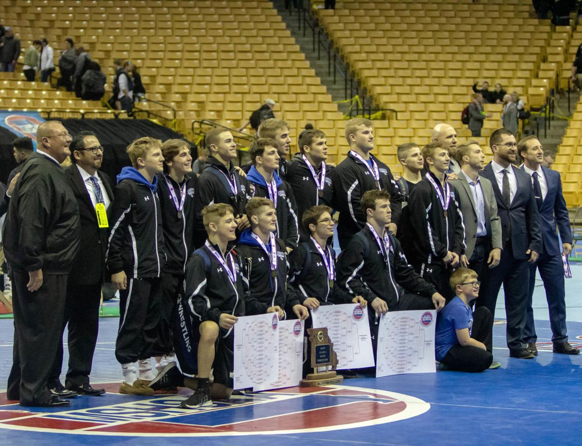 Liberty's Brewer earns NWCA Scholastic Coach of the Year Award