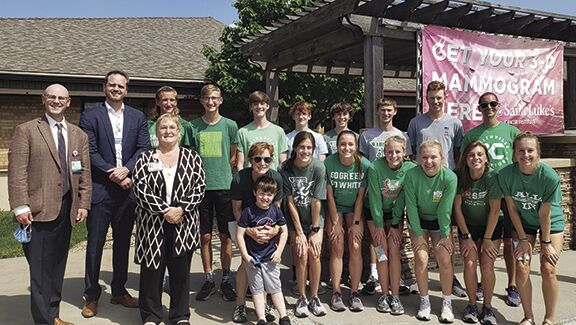 Smithville Cross Country presents $3,000 to Saint Luke's North Breast & Imaging Center