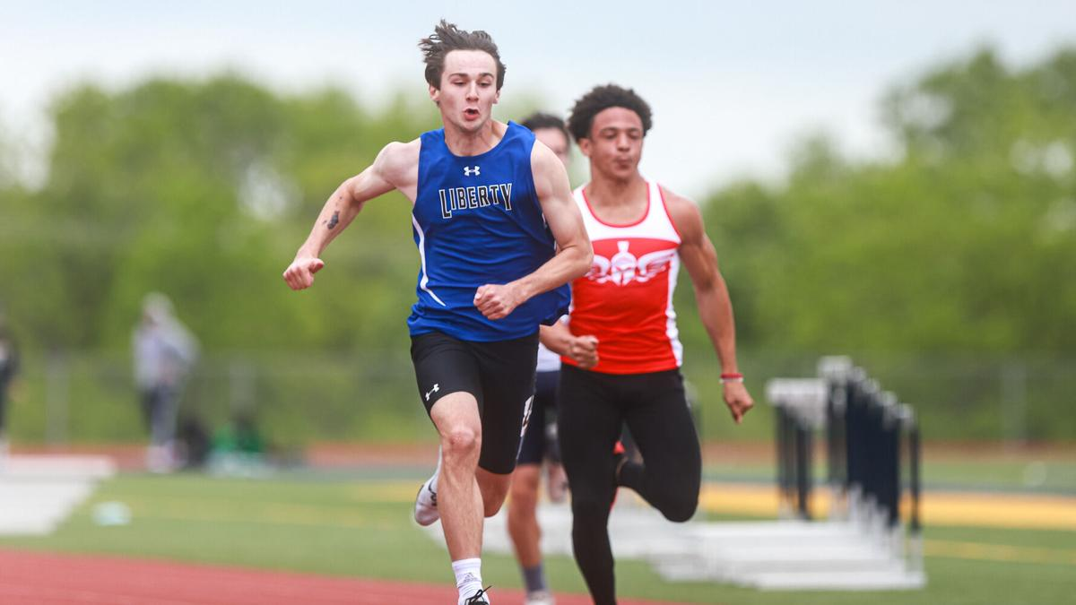 Liberty boys track edges out Liberty North for district title