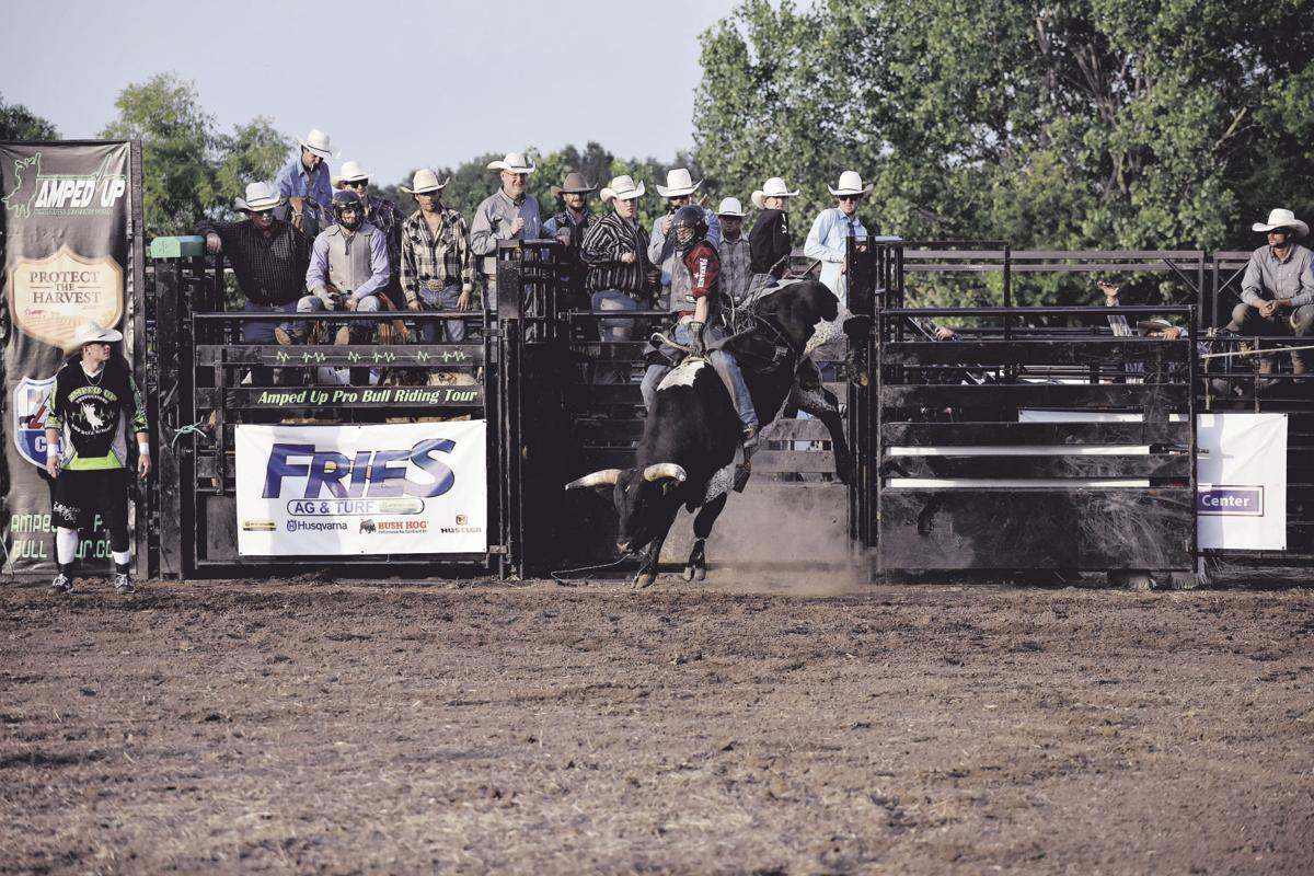 Bull riders hold on