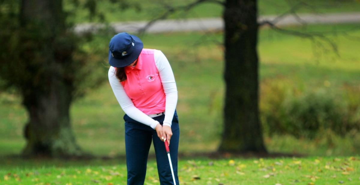 District golf dampened by rain