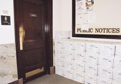 Sealed boxes with assessment records line hallways