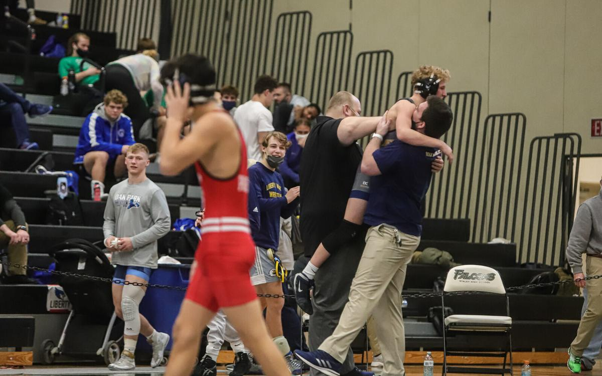 18 boys wrestlers from Liberty, Liberty North advance to state