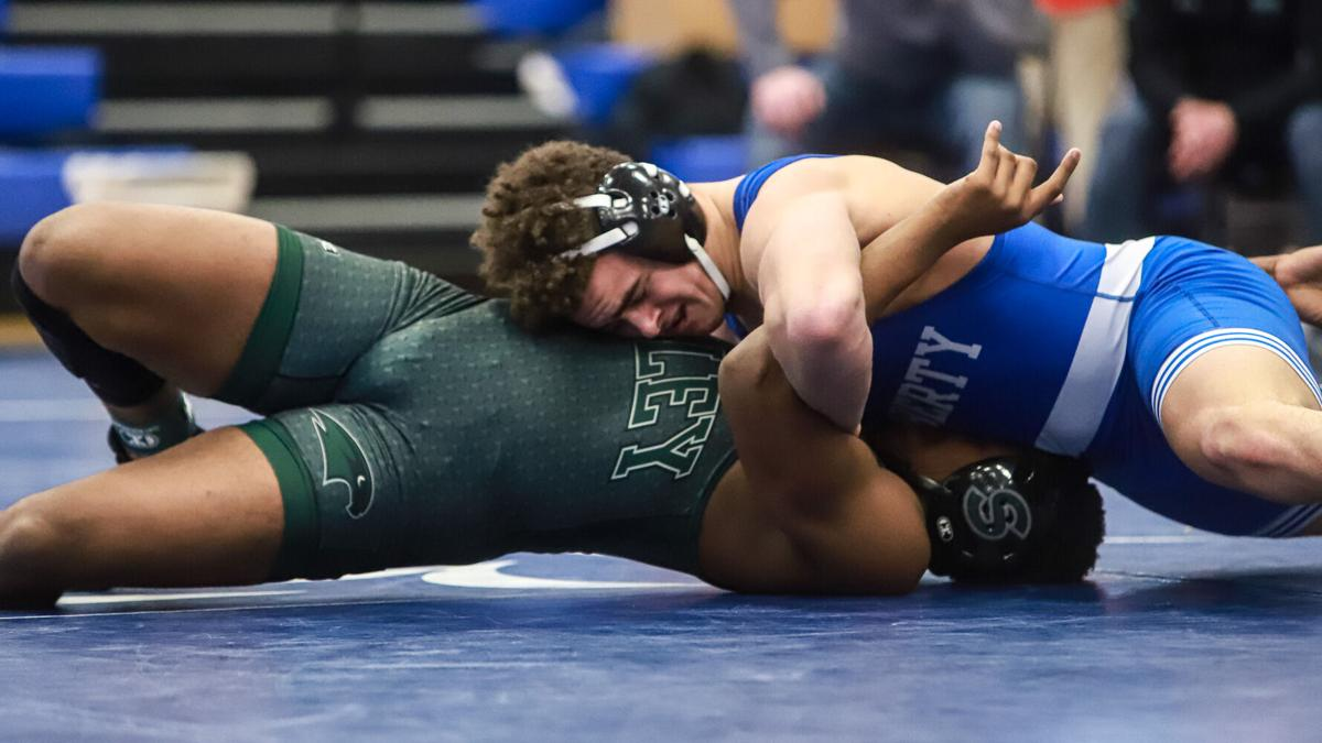 Liberty boys wrestling dominates districts to win team title for third straight year