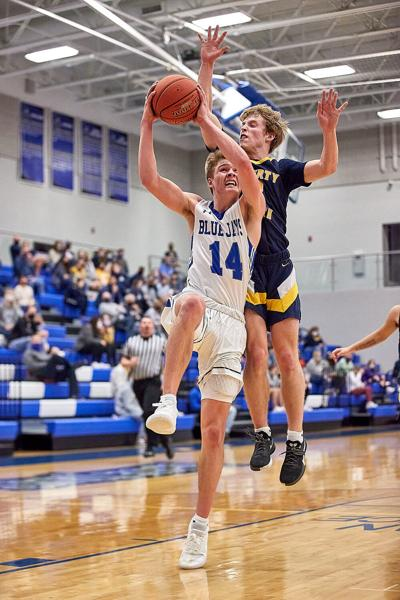 Liberty boys hoops beat Liberty North in district semis