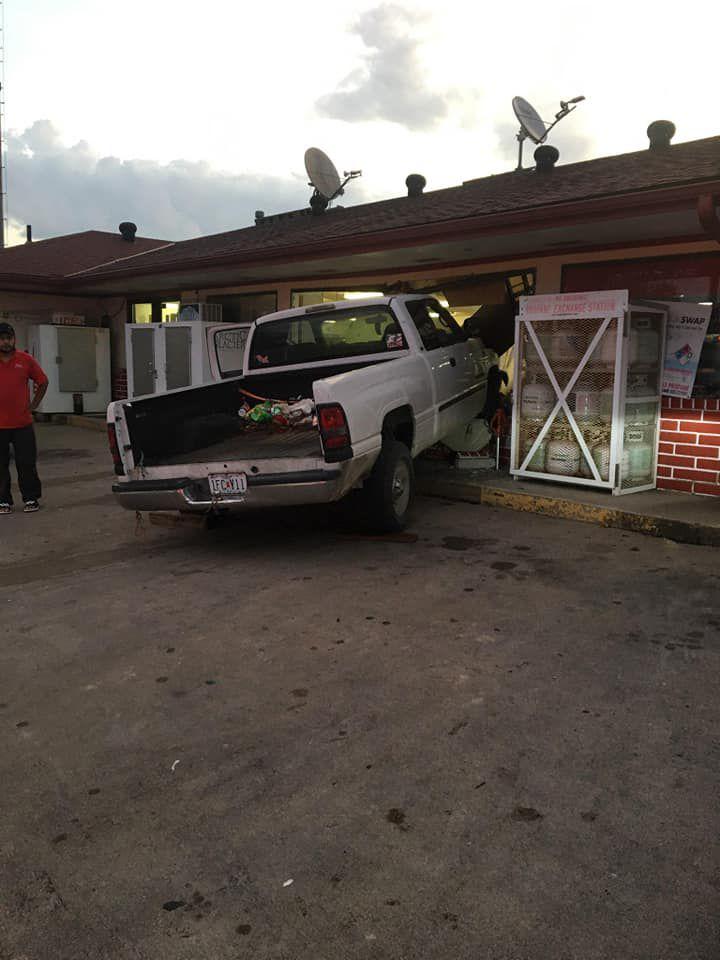 Truck slams into truck stop window