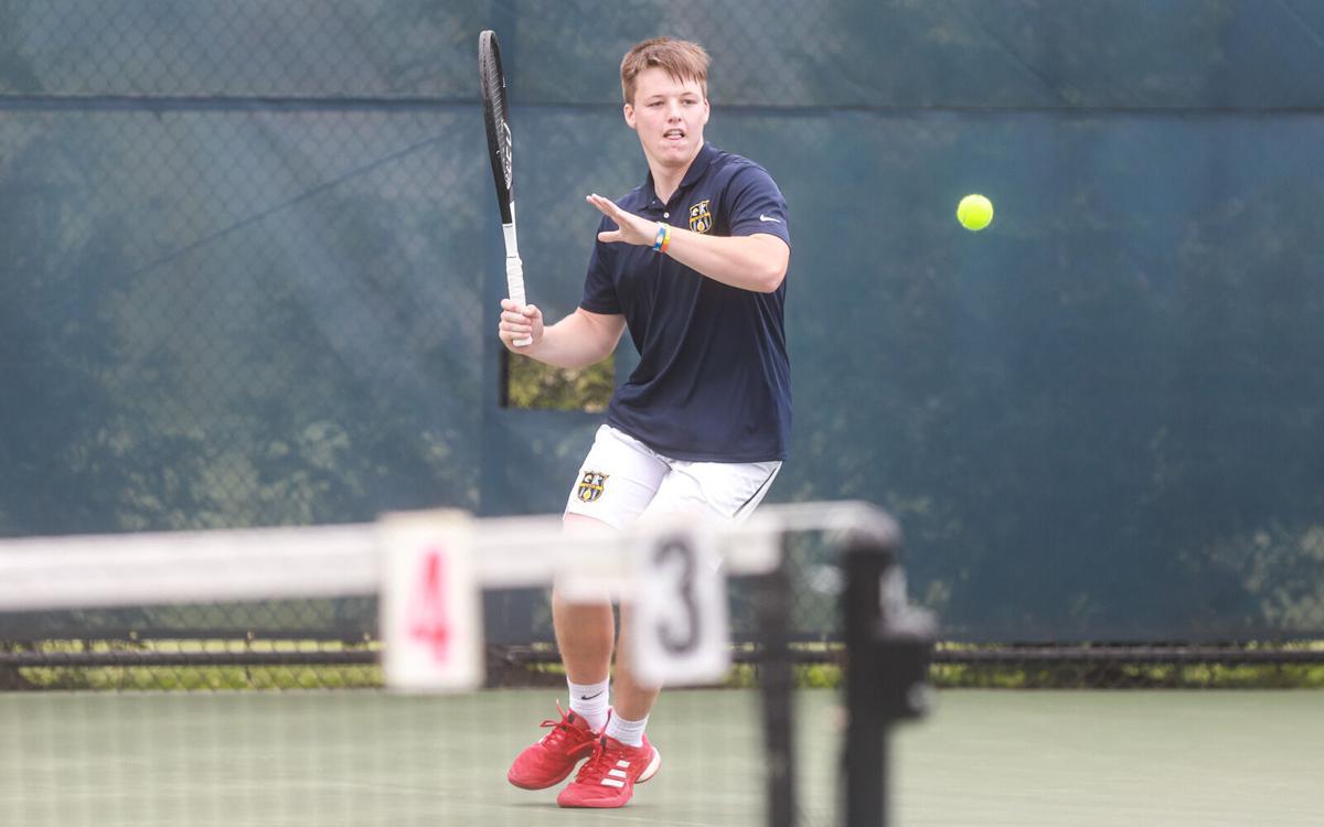 Liberty and Liberty North boy tennis at individual districts.jpg