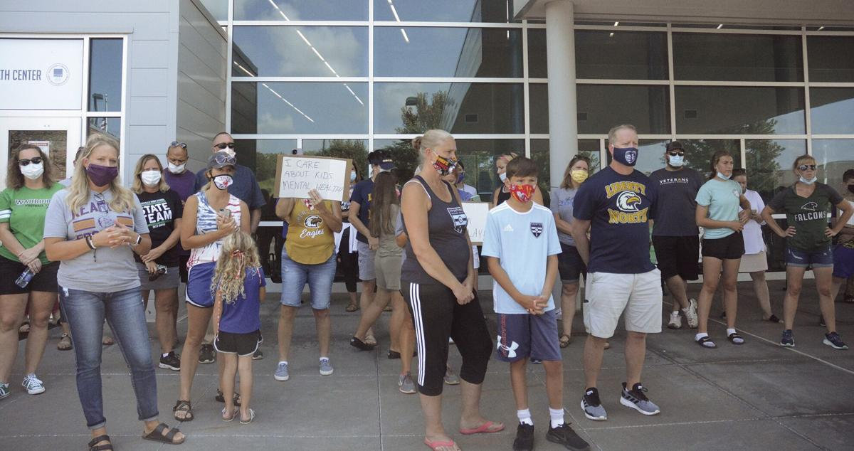 Protest brings out families supporting fall sports