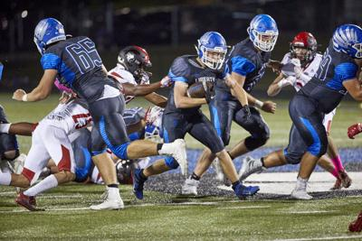 Liberty football overcomes early deficit, injured star in 24-21 win