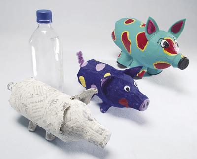 Creating papier-mache pigs is gooey fun