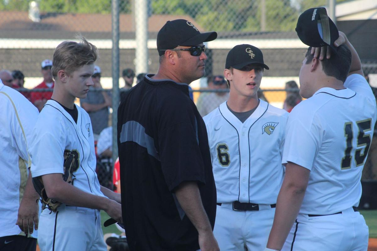 Martin talks with players